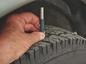Photo 4: Measuring wear across the tire tread can reveal the need for a tire rotation and perhaps a wheel alignment.