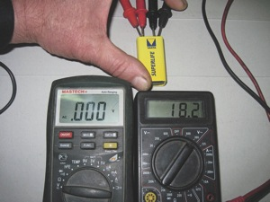 figure 3: comparing two dmms connected to a 9v battery.